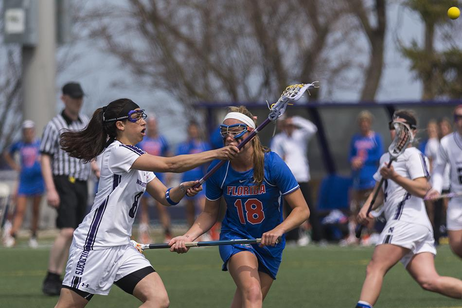 Lacrosse: Wildcats' rally falls short as rival Gators clinch regular season conference title