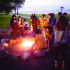 "Students gather at the bonfire held by Real Food at NU on Wednesday evening at the lakefill. The organization started posting banners promoting ""local, sustainable, humane or fair trade"" food in all dining halls."