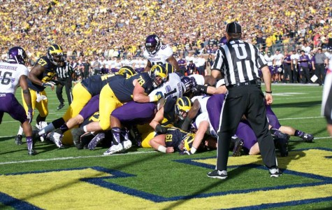 Captured: Football falls to Michigan