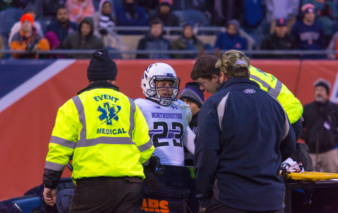 Football: Nick VanHoose carted off with apparent head injury