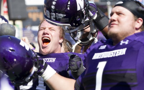Northwestern defensive linemen Brian Arnfelt (left) and Bo Cisek (right) celebrate after the Wildcats' win over Indiana. As of the fifth week of its season, Northwestern is the only undefeated team in the Legends division.