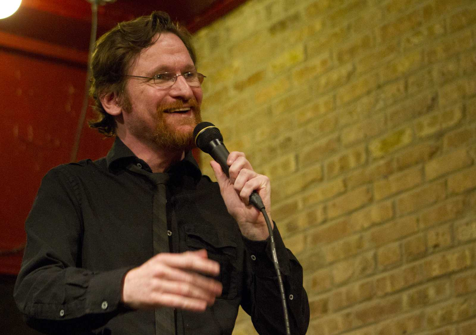 Comedian Adam Burke performs for an audience of 15 at Evanston's J.J. Java. The event was part of a new weekly show at the local coffee shop.