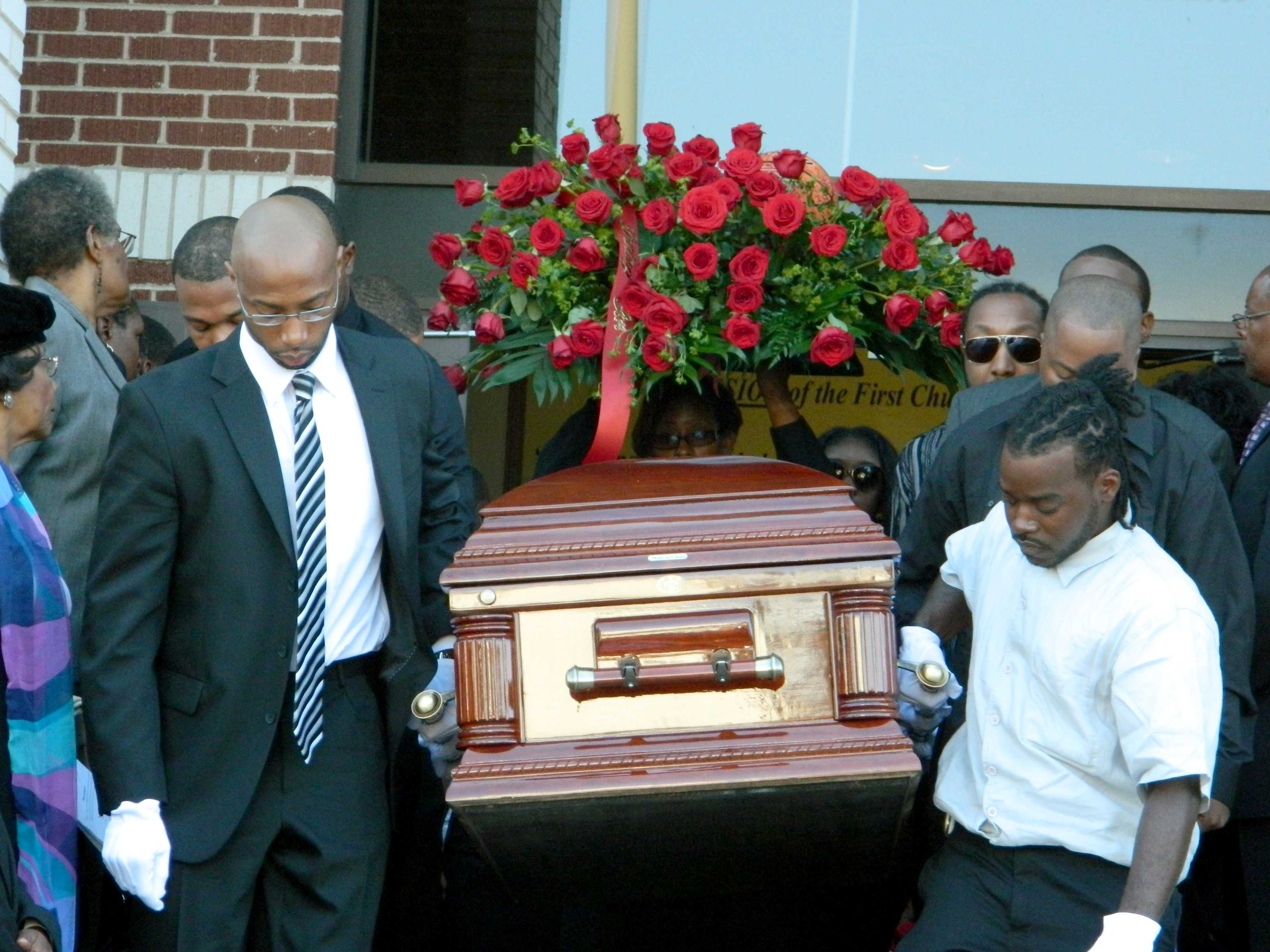Dajae Coleman's body is carried out of the church after the funeral services, which were conducted by Pastor Kenneth Cherry.