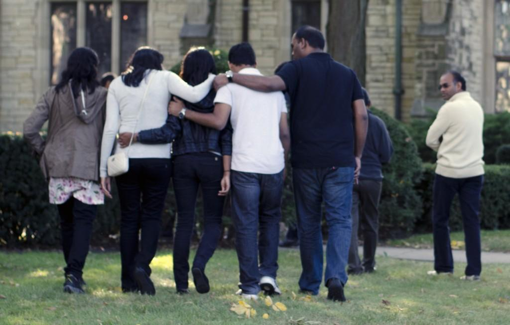 Maddula family members walk away after a news conference Friday. Sushma Maddula, Harsha Maddula's cousin, told reporters that her family still wants answers about the McCormick sophomore's death.