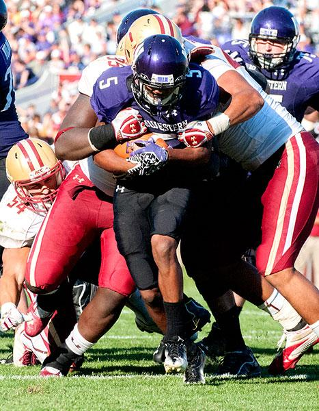 Northwestern running back Venric Mark is wrapped up for a tackle. Mark is a very physical back despite his small stature. (Gabriel Peal/The Daily Northwestern)