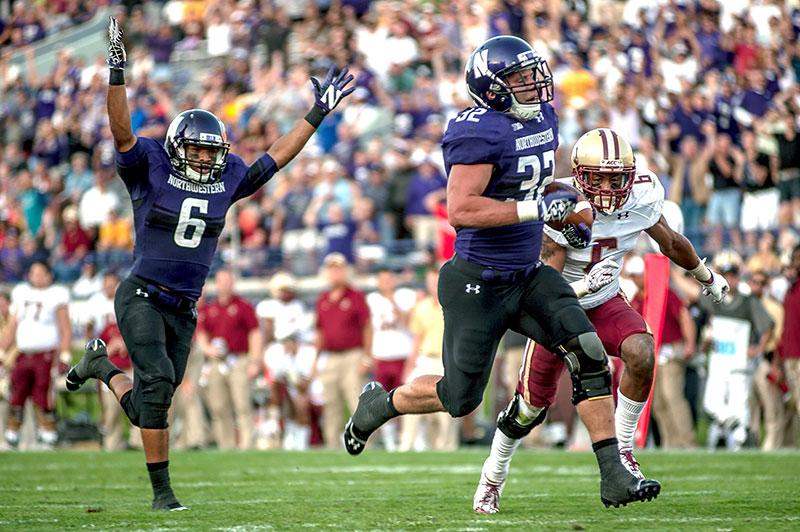 Northwestern+running+back+Mike+Trumpy+runs+for+a+touchdown+while+wide+receiver+Tony+Jones+celebrates.+Trumpy%E2%80%99s+27-yard+run+came+on+the+Wildcats%E2%80%99+100th+and+final+play.+%28Rafi+Letzter%2FThe+Daily+Northwestern%29