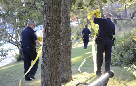 Police officers remove the crime scene tape surrounding the harbor Wednesday evening. As of Wednesday night, Maddula has not been found.