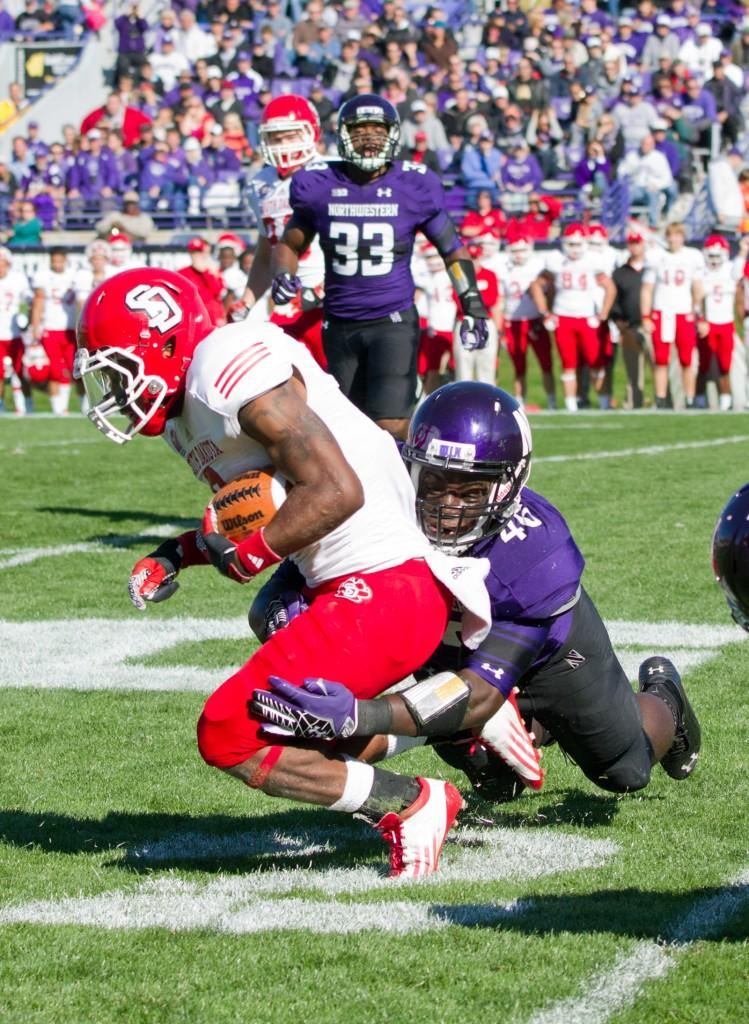 Northwestern+linebacker+Damien+Proby+takes+down+wide+receiver+Terrance+Terry+of+South+Dakota+during+Saturday%E2%80%99s+game.