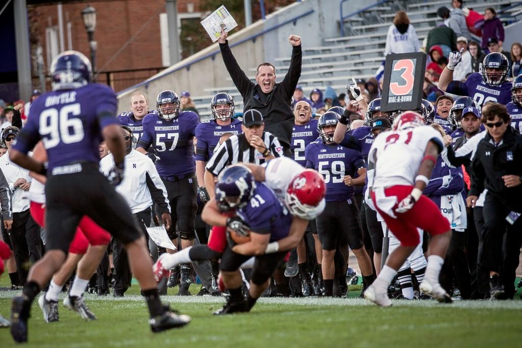 Northwestern+Coach+Pat+Fitzgerald+%28center%29+celebrates+as+wide+receiver+Doug+Diedrick+is+brought+down+for+the+final+Wildcat+pass+of+the+game+in+the+fourth+quarter.+The+Wildcats+had+408+yards+of+total+offense+throughout+the+game.