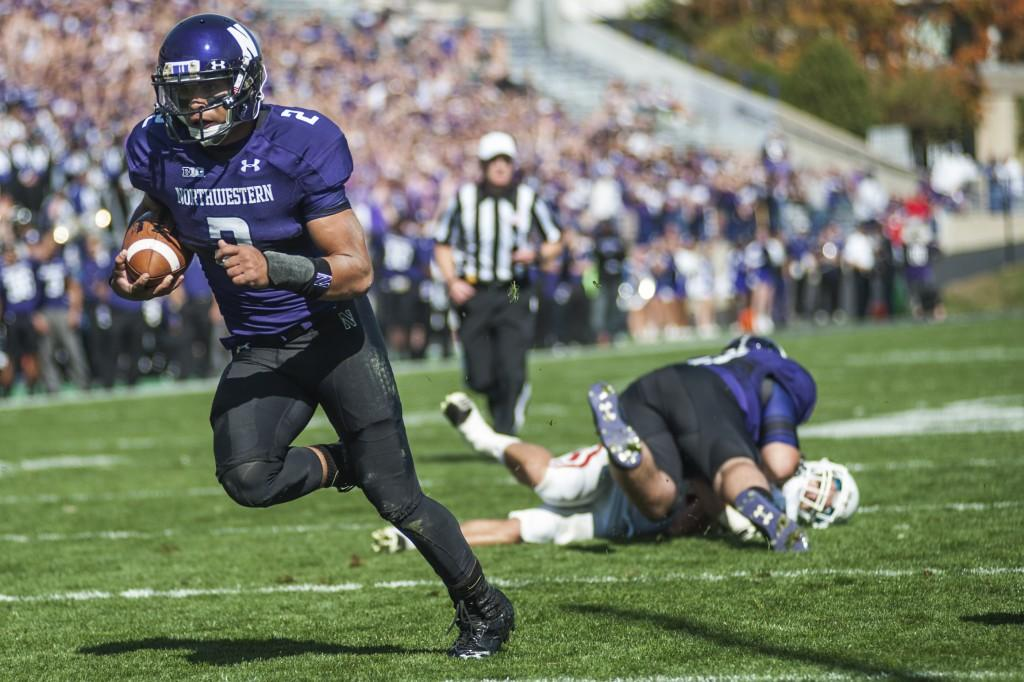 Northwestern+quarterback+Kain+Colter+scores+one+of+four+rushing+touchdowns+during+Saturday%27s+game+against+Indiana.+Colter+finished+the+game+with+161+yards+rushing.