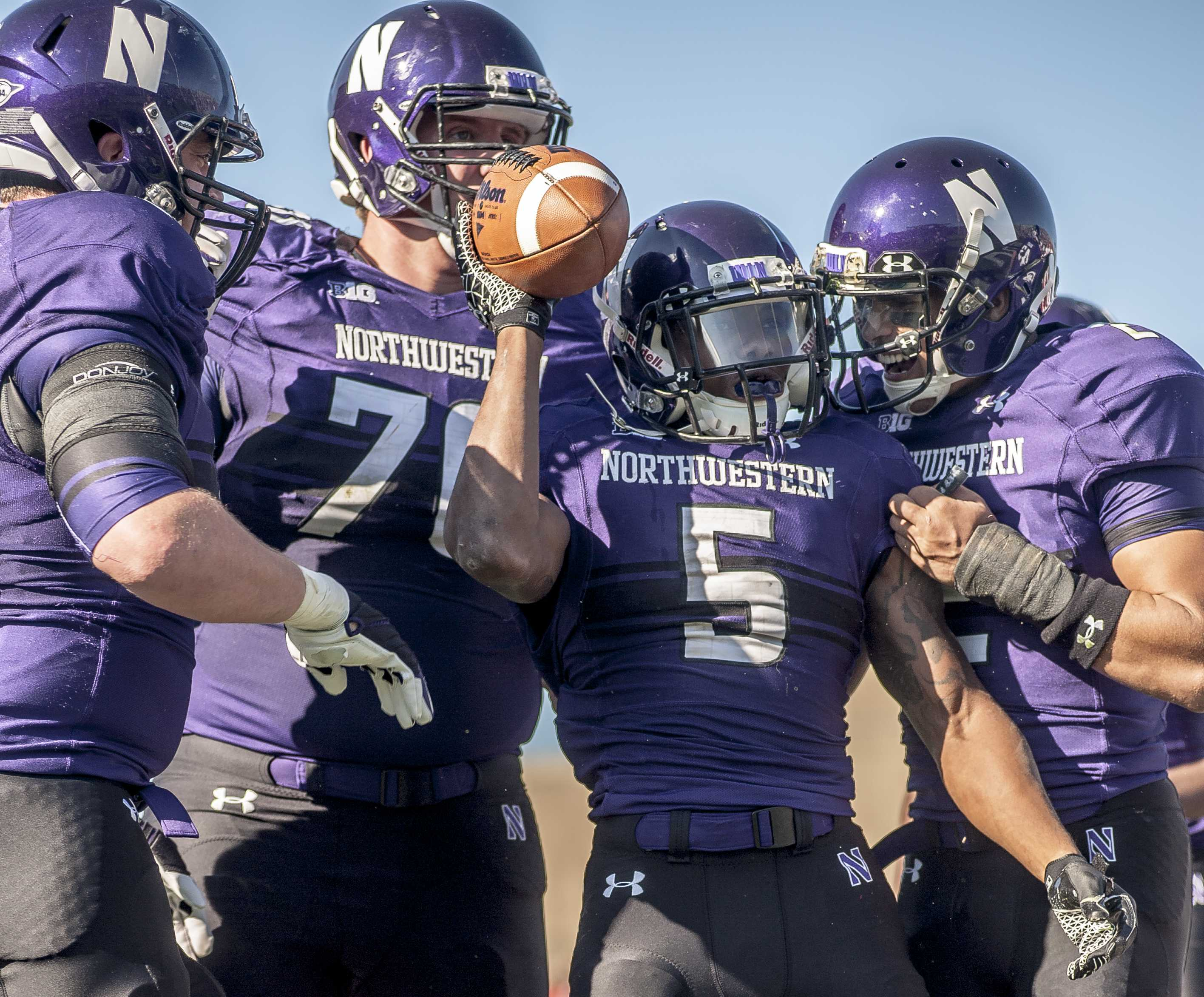 Venric Mark celebrates the first of his three rushing touchdowns in the first half. The junior running back had 97 yards rushing in the first half to propel NU to a 28-0 lead.