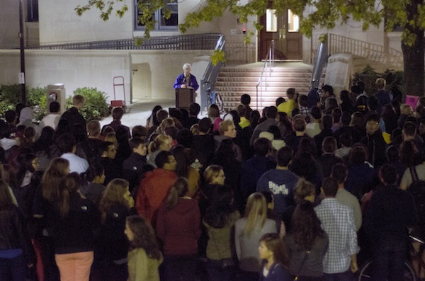 University chaplain Timothy Stevens addresses the students and faculty in attendance at the vigil that was previously planned in solidarity with Maddulas family. The vigil was planned before the press conference was announced.