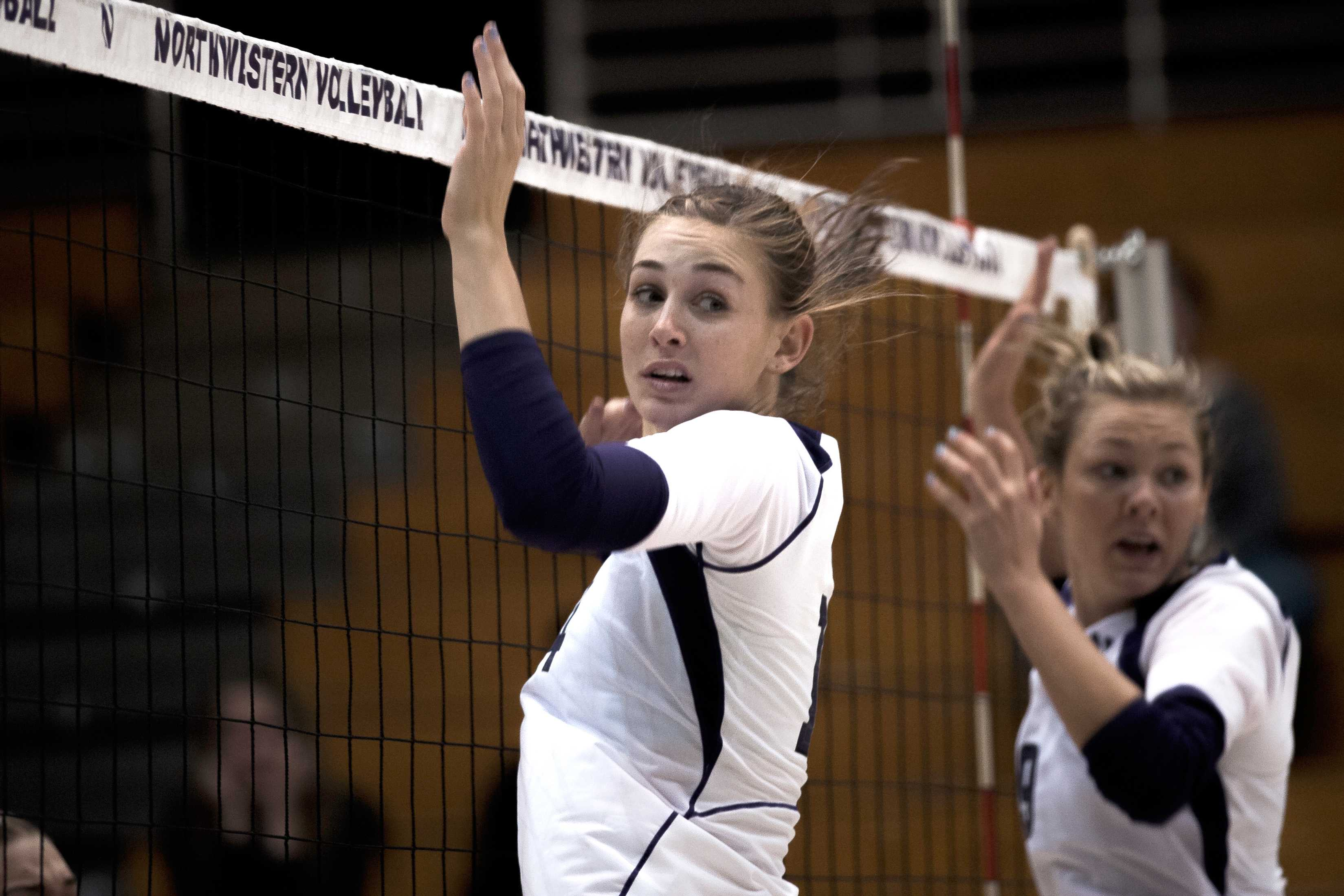 Northwestern middle blocker Katie Dutchman (center) and safety Madalyn Shalter (right) react as a ball sails past them in the final set of their Sept. 23 defeat by Minnesota.