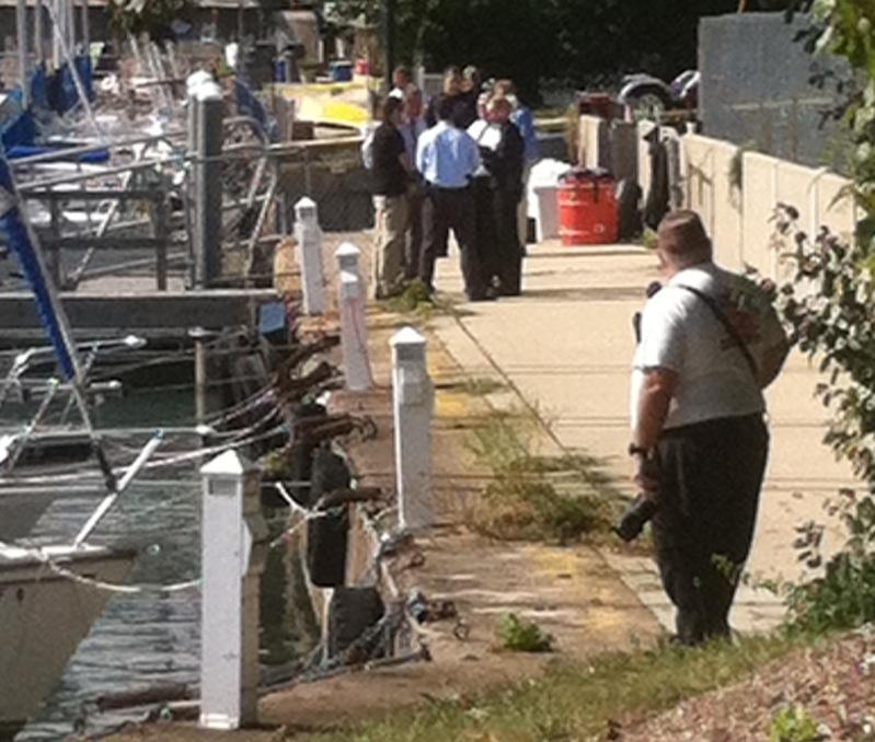 Authorities watch as U.S. Coast Guard divers search Wilmette Harbor for Maddula's body. The harbor is connected to Lake Michigan and is about two miles north of Technological Institute on the NU campus.