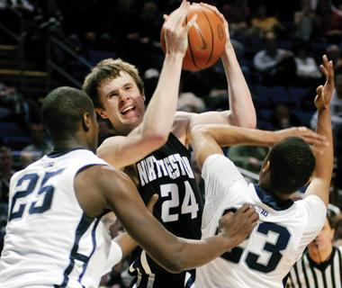 John Shurna fights to bring the Wildcats victory over Penn State, 67-66, in February. Shurna was signed to the New York Knicks with a partially guaranteed contract.