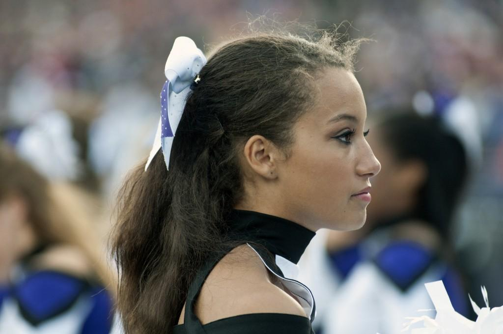 A Northwestern cheerleader watches Northwestern lose after leading for two quarters in Saturday's game against Nebraska.