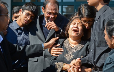 Family members grieve outside Harsha Maddula's funeral in New Hyde Park, N.Y. Northwestern chaplain Timothy Stevens reportedly spoke during the service.