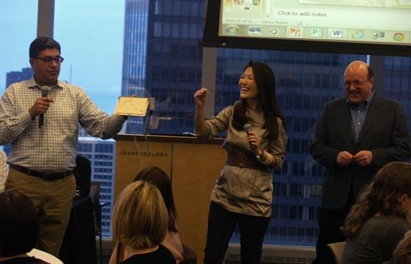 Ameet Sachdev (far left), co-president of Asian American Journalists Association Chicago, holds a raffle prize at the chapter's 2011 scholarship fund. He is pictured with co-president Susanna Song (center) and Robert Feder, the media critic at Time Out Chicago (far right). AAJA is increasing its presence on NU's campus with the assistance of new Medill professor and longtime member Mei-Ling Hopgood.