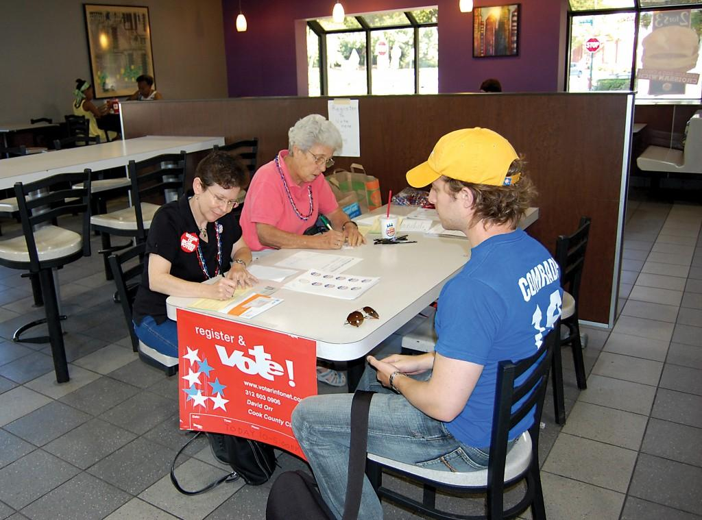 Members of the League of Women Voters conduct a voter registration drive at Burger King in Evanston in 2008. As the 2012 election approaches, Northwestern is attempting to remove obstacles to student voters.