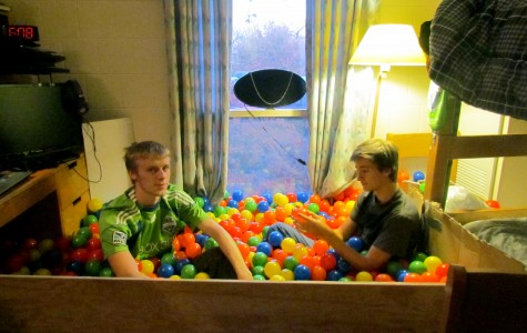 Weinberg freshman Casey Kendall and Bienen freshman Jon Bauerfield, roommates in 1835 Hinman, talk to each other in their newly installed ball pit. The pit has attracted people to their room and helped them meet other new students.
