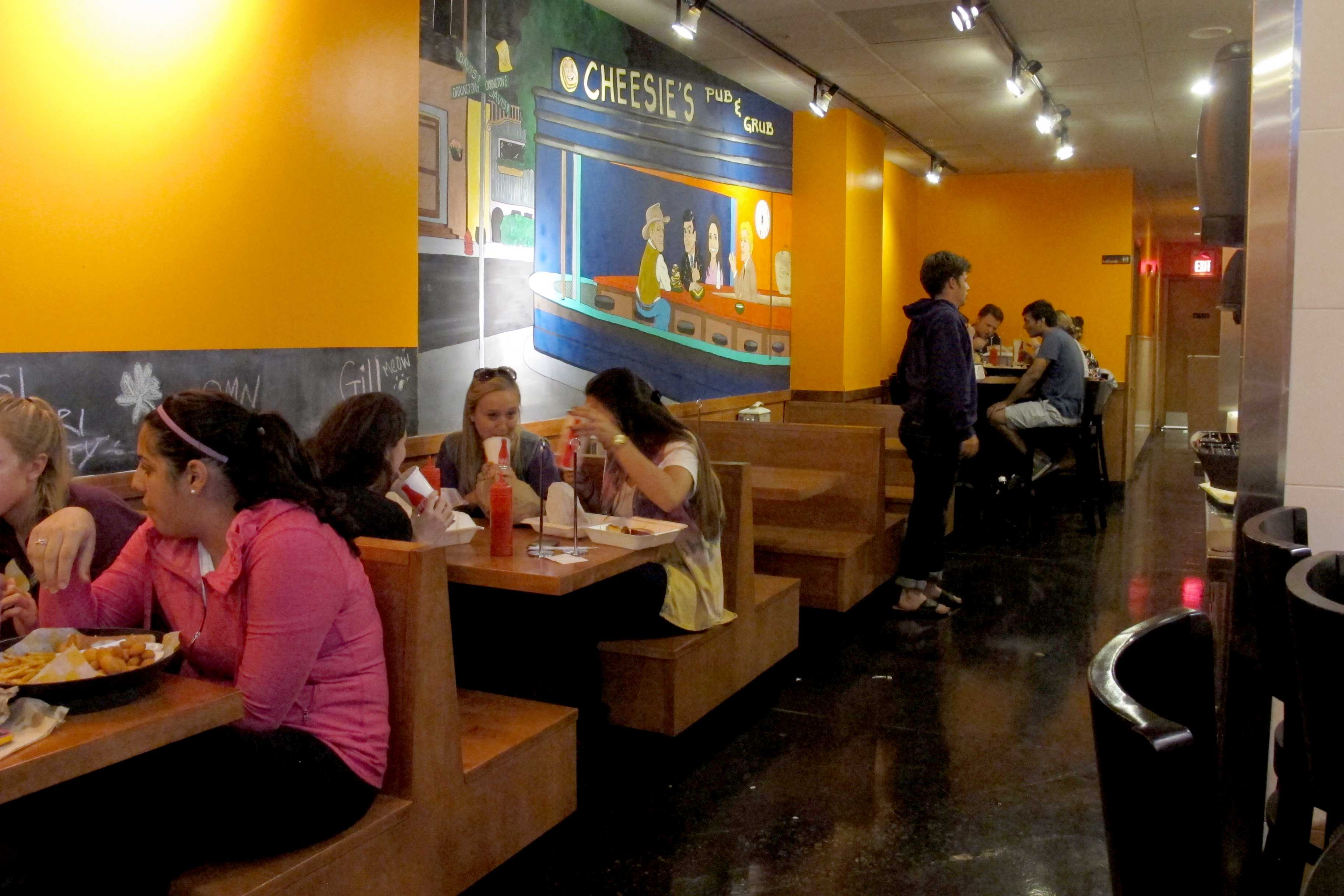 Northwestern students dine at Cheesie's. The Davis Street restaurant has become a popular spot for students, given the few Evanston restaurants that stay open late.