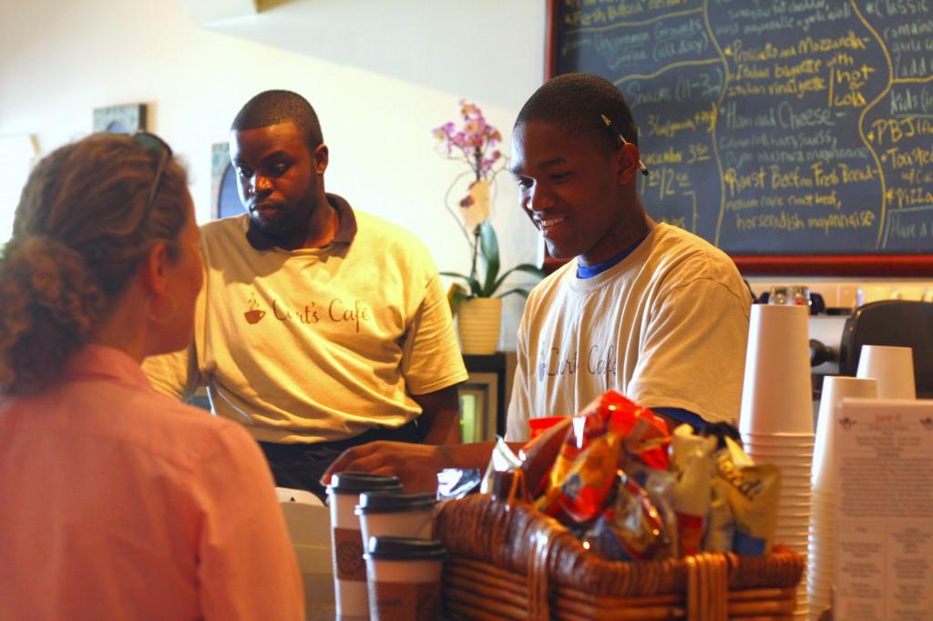 Curt%27s+Cafe+employee+Chandel+Ramsey+takes+an+order+at+the+cafe.+Ramsey+found+work+after+graduating+from+the+cafe%27s+restaurant+training+program.+