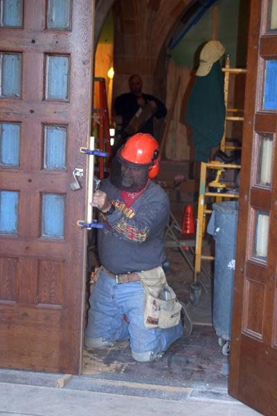 A worker takes part in preparations for opening the front doors of Deering Library to the public. Construction was done in the lobby and the exterior of the library. The doors will officially open Saturday of Homecoming weekend.