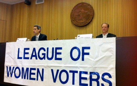 Rep. Daniel Biss (D-Evanston) (left) explains his view on progressive tax as Republican candidate Glen Farkas (right) listens. The two 9th District candidates spelled out their views during a Sunday debate hosted by the League of Women Voters at Wilmette Village Hall.