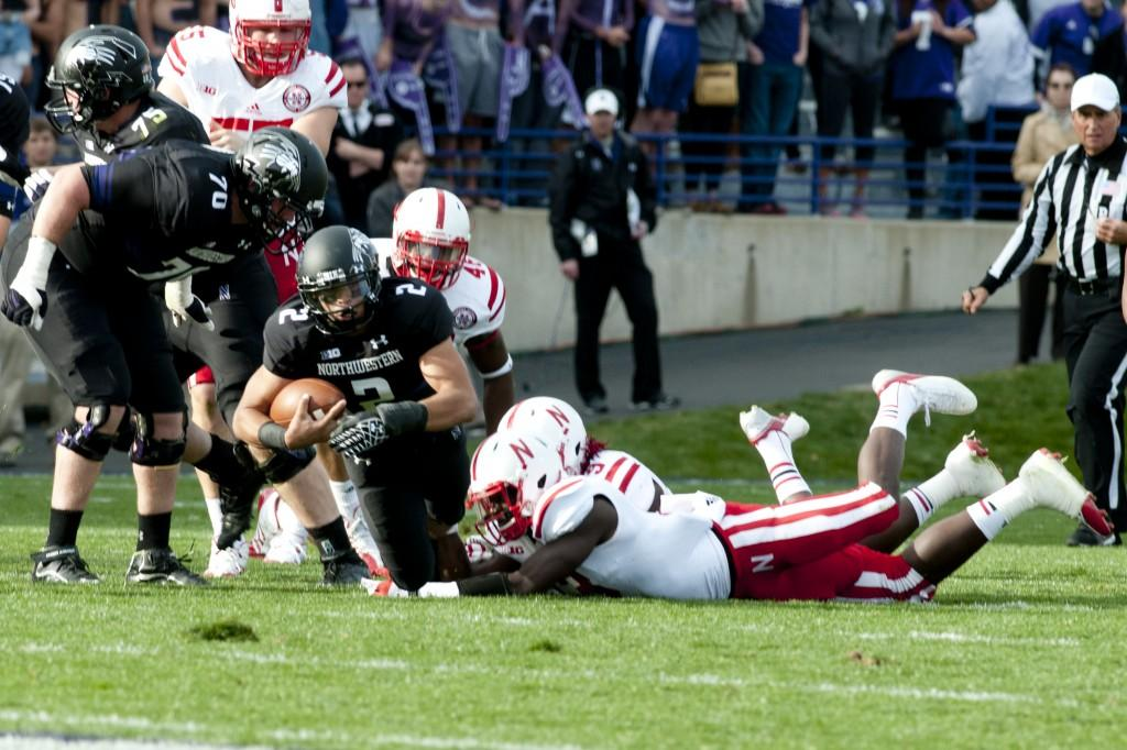 Northwestern+quarterback+Kain+Colter+is+brought+down+trying+to+escape+a+tackle+in+Saturday%27s+game+against+Nebraska.+The+Wildcats+lost+29-28+after+a+late+Cornhusker+rally.+