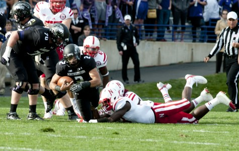 Northwestern quarterback Kain Colter is brought down trying to escape a tackle in Saturday's game against Nebraska. The Wildcats lost 29-28 after a late Cornhusker rally.