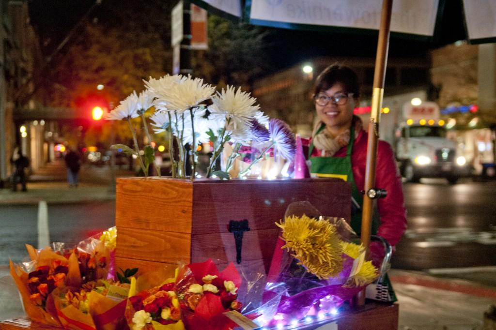 "Flower Bike operator Mya Huynh says she sells blooms part-time ""for fun,"" to meet strangers and hear their stories."