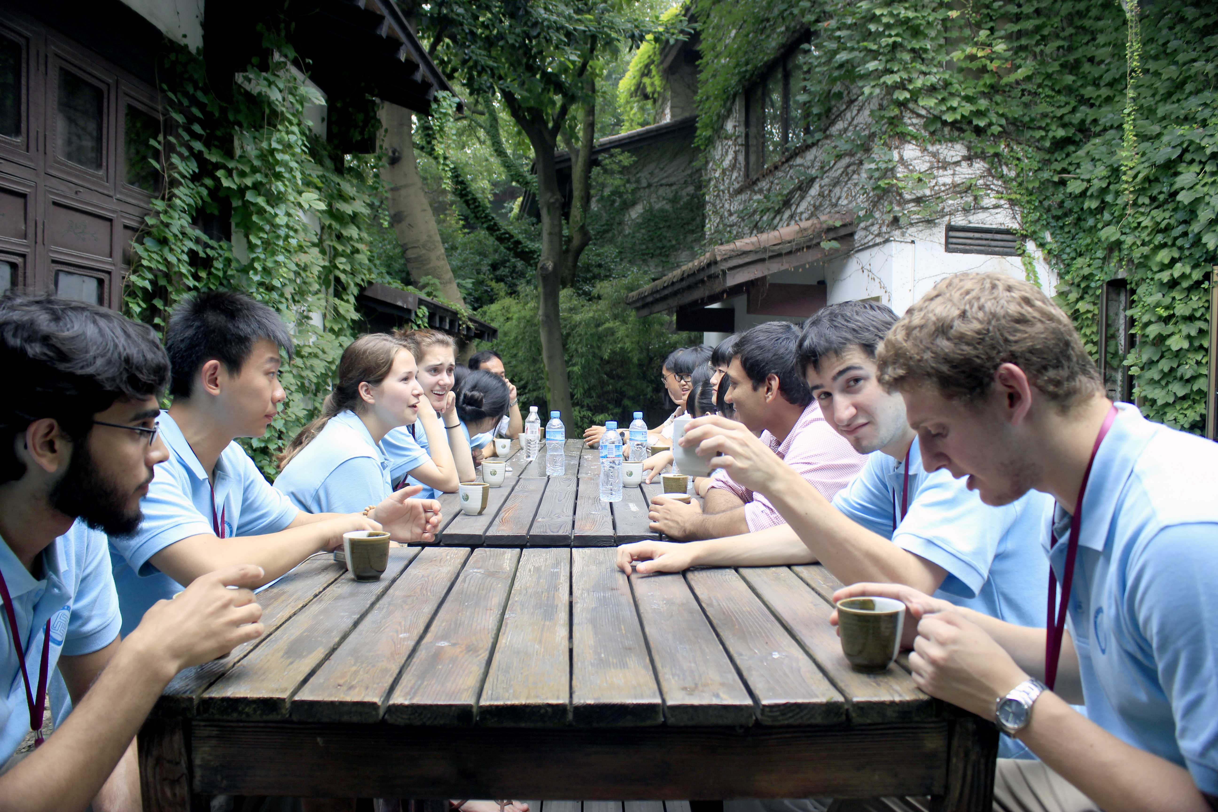 Northwestern students from the Green Tech trip to China have tea together. The trip was funded by a federal grant proposed by President Barack Obama.