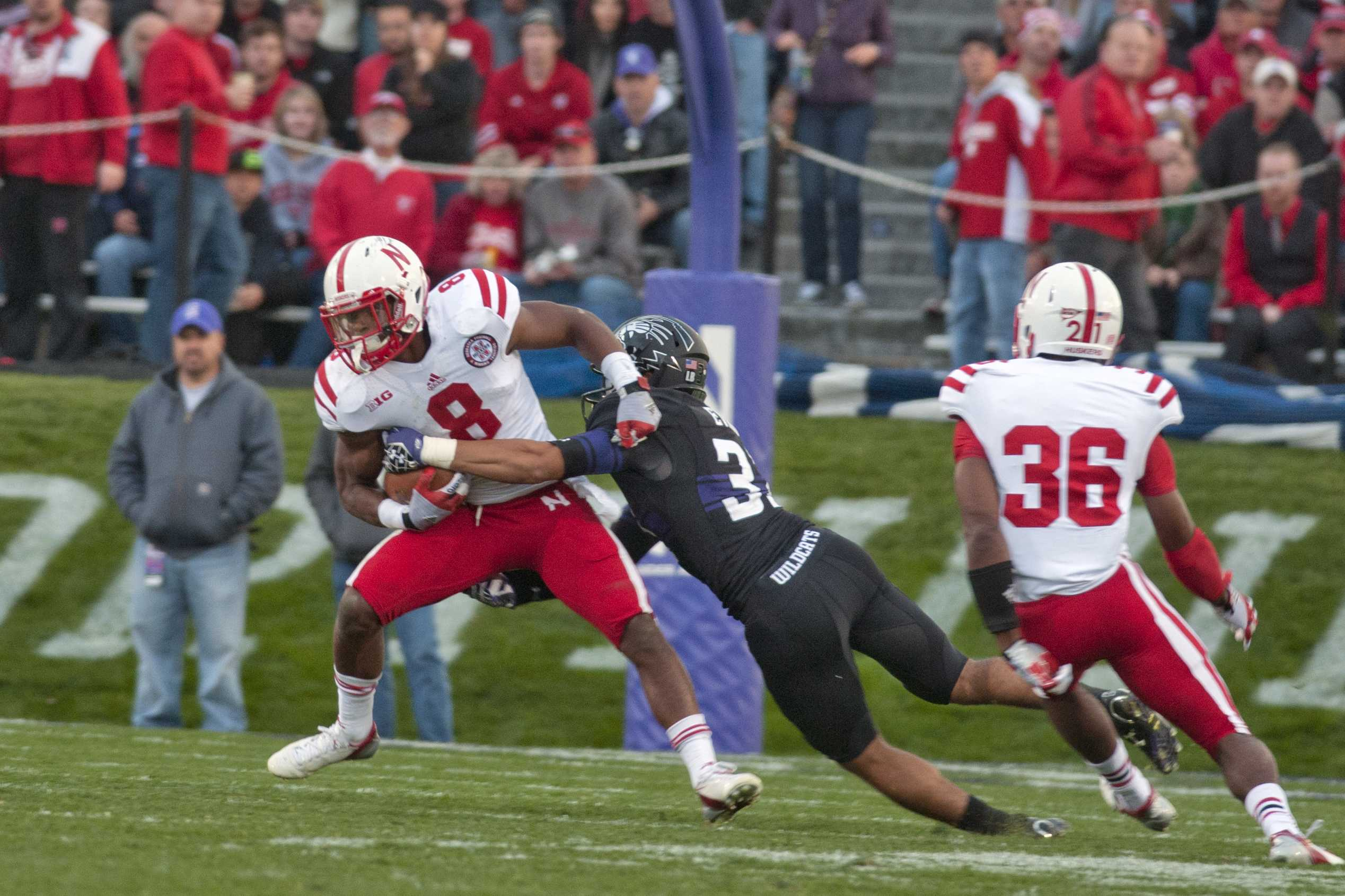 Northwestern cornerback Quinn Evans misses a tackle on Nebraska running back Ameer Abdullah. Abdullah finished with 101 yards on 19 carries.