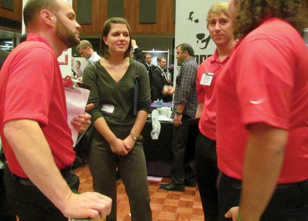 McCormick junior Molly Baker talks to representatives from Bemis. Baker attended the Society of Women Engineers Industry Day on Thursday.