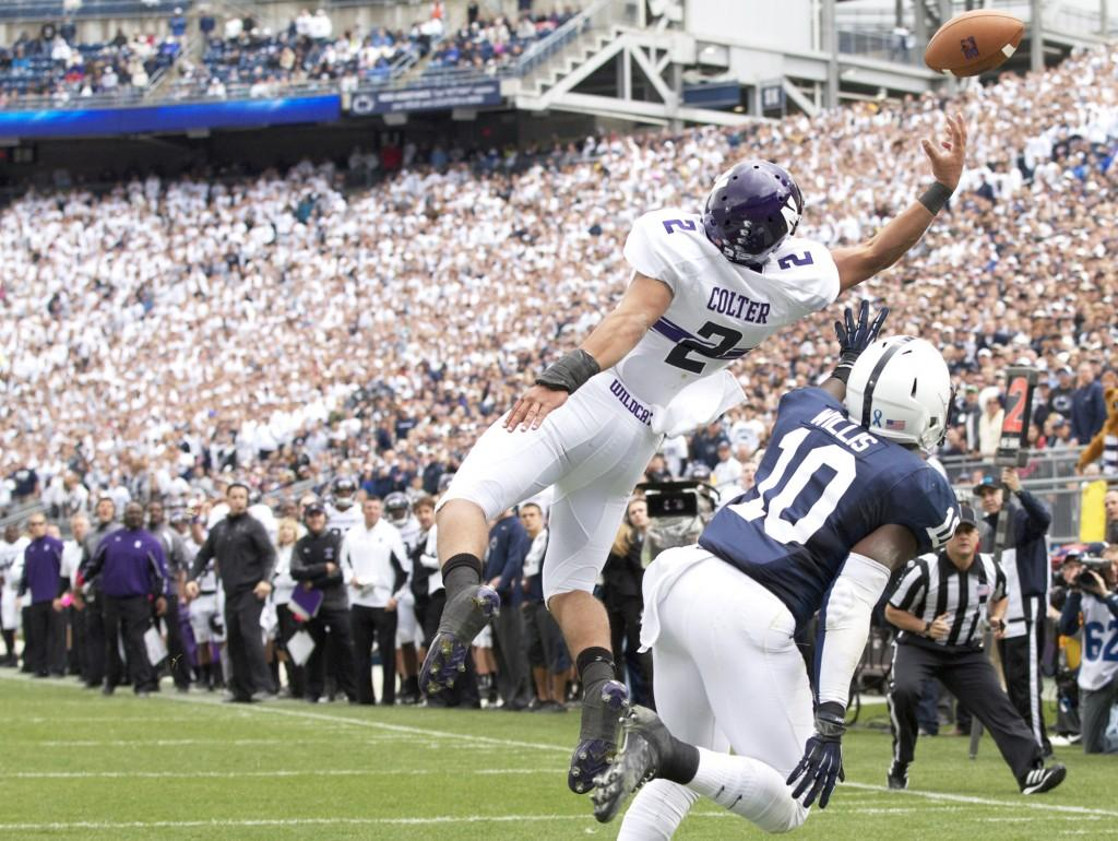 Northwestern+quarterback+Kain+Colter+reaches+for+a+pass+in+the+endzone.+Colter+finished+the+Saturday%27s+game+against+Penn+State+with+only+three+catches+for+17+yards.