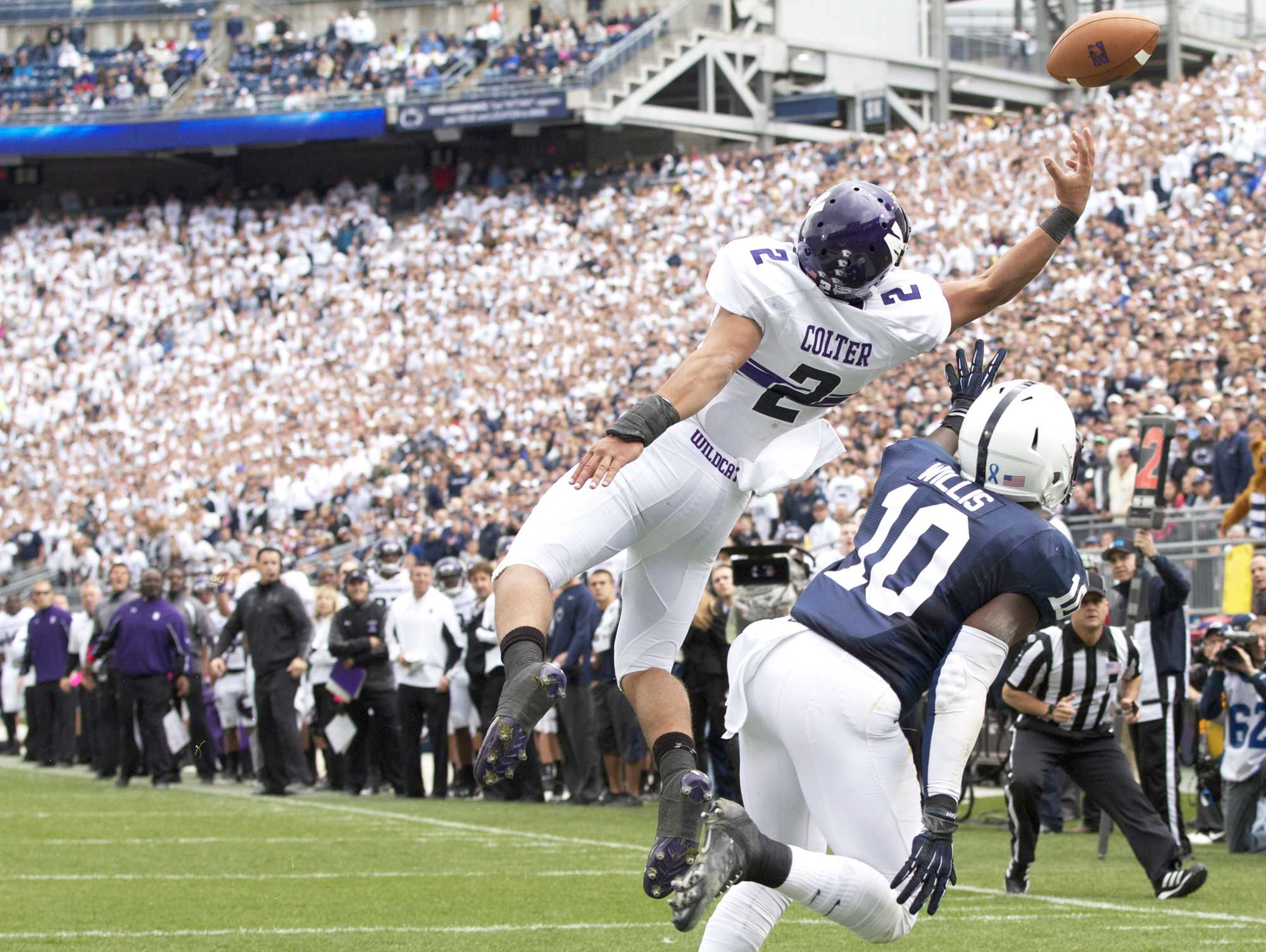 Northwestern quarterback Kain Colter reaches for a pass in the endzone. Colter finished the Saturday's game against Penn State with only three catches for 17 yards.