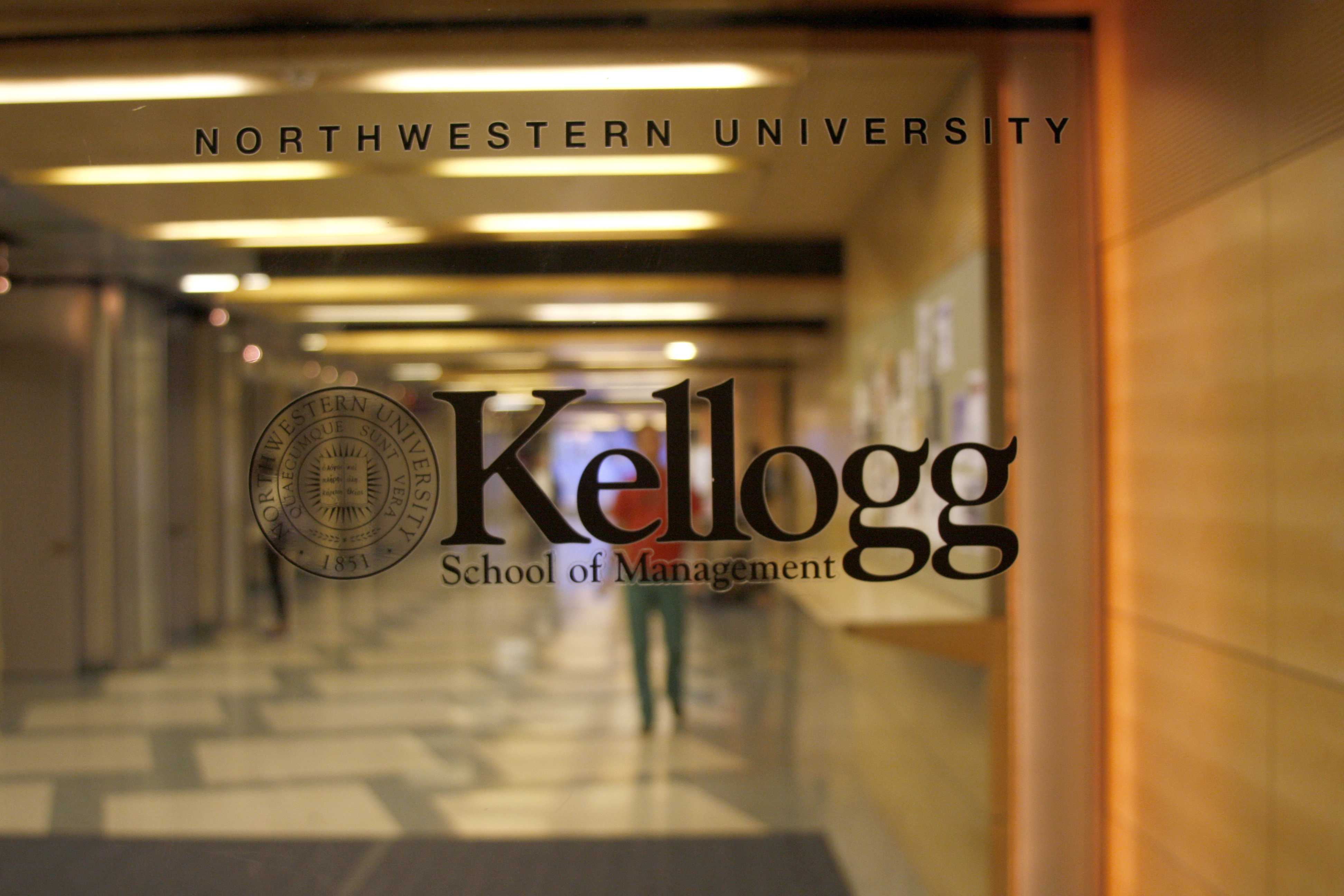 Students enter Kellogg School of Management. Kellogg professors contributed to the establishment of Illinois's first health insurance co-op under the federal health care law.