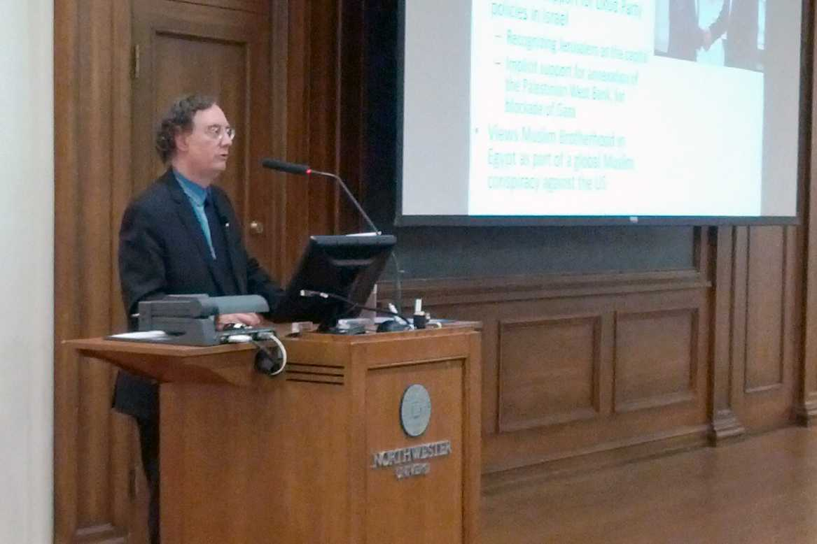 University of Michigan professor and historian Juan Cole discusses foreign policy in the Middle East in Harris Hall on Monday night. Cole, an expert on the modern Middle East and South Asia, contrasted the presidential candidates' foreign policy views.
