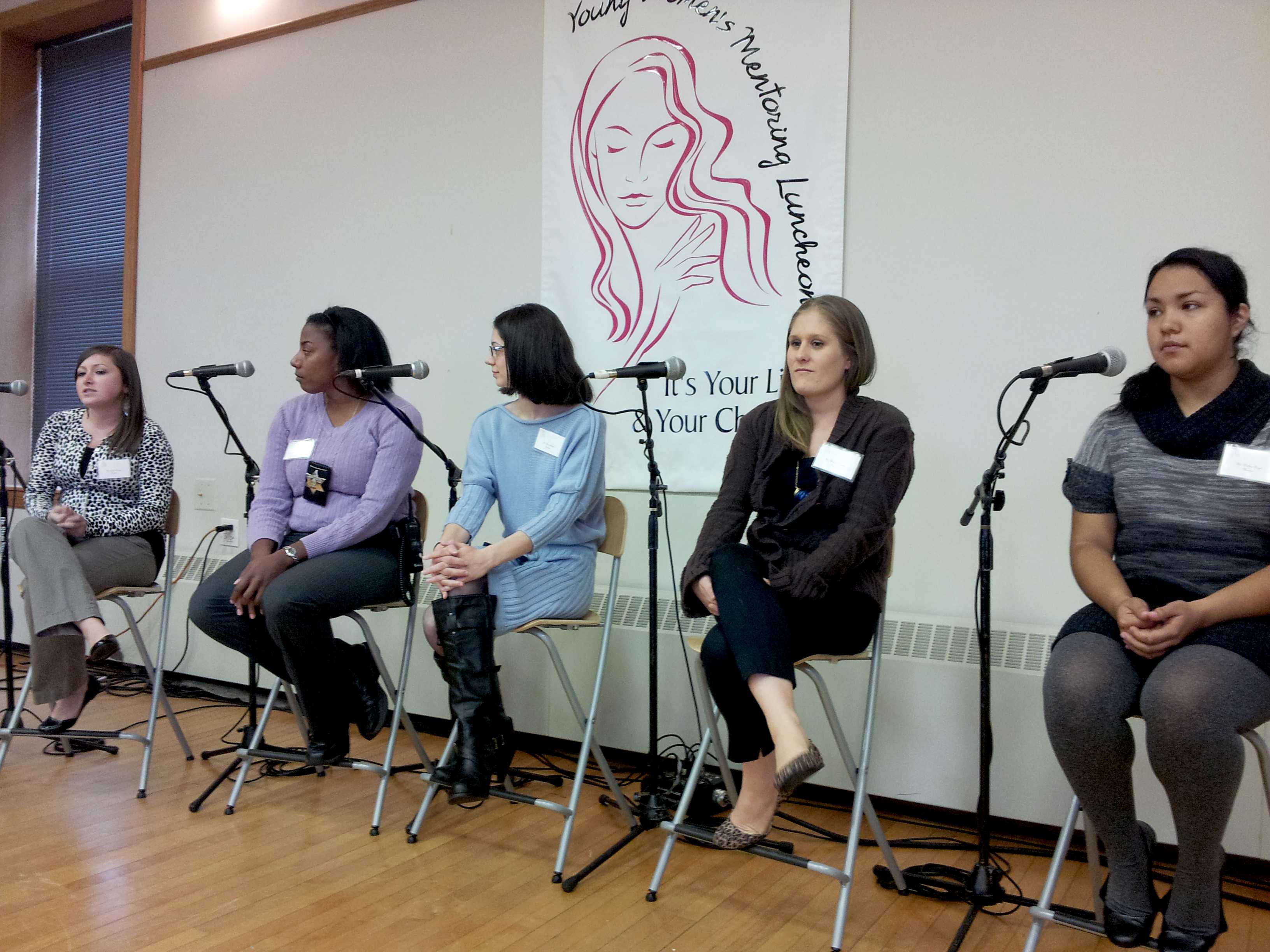 Panelists Jessica Gorman, Grace Carmichael, Dena Shibib, Christine Newton and Darlene Reyes speak to Evanston young women about health, friends, college and living well at the Young Women's Mentoring Luncheon at the Lorraine H. Morton Civic Center.
