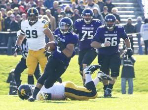 Football: Northwestern running game propels Homecoming victory over Iowa