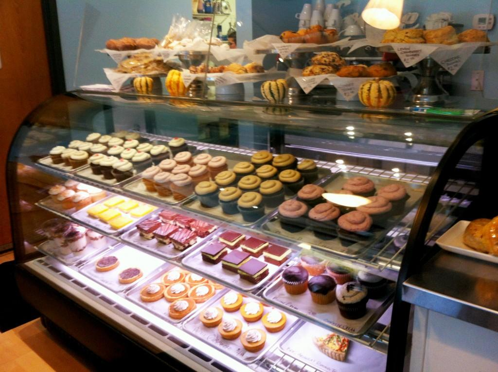 The pastry case is filled with delicious treats.