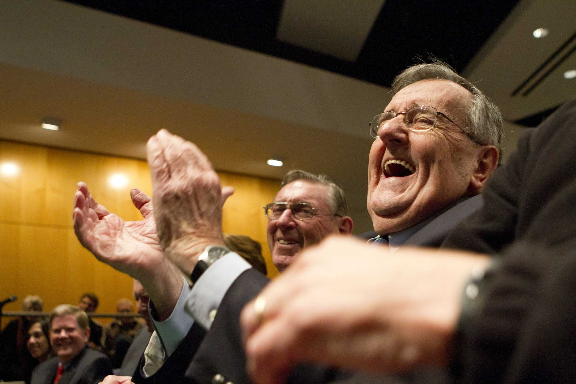 Mark Shields of PBS NewsHour laughs as professor emeritus Newton N. Minow introduces him at Tuesday's Newton Minow lecture. Shields spoke to a full auditorium at the McCormick Tribune Center about his experiences covering the 2012 presidential race and the responsibilities of political journalists.