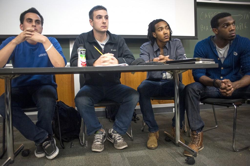 Northwestern+students+Daniel+Flores%2C+Andrew+Jarrell%2C+Justin+Clarke+and+Tarik+Patterson+%28left+to+right%29+debate+race-based+affirmative+action+policies+in+higher+education.+About+60+students+participated+in+the+Northwestern+Political+Union+event+Monday.+
