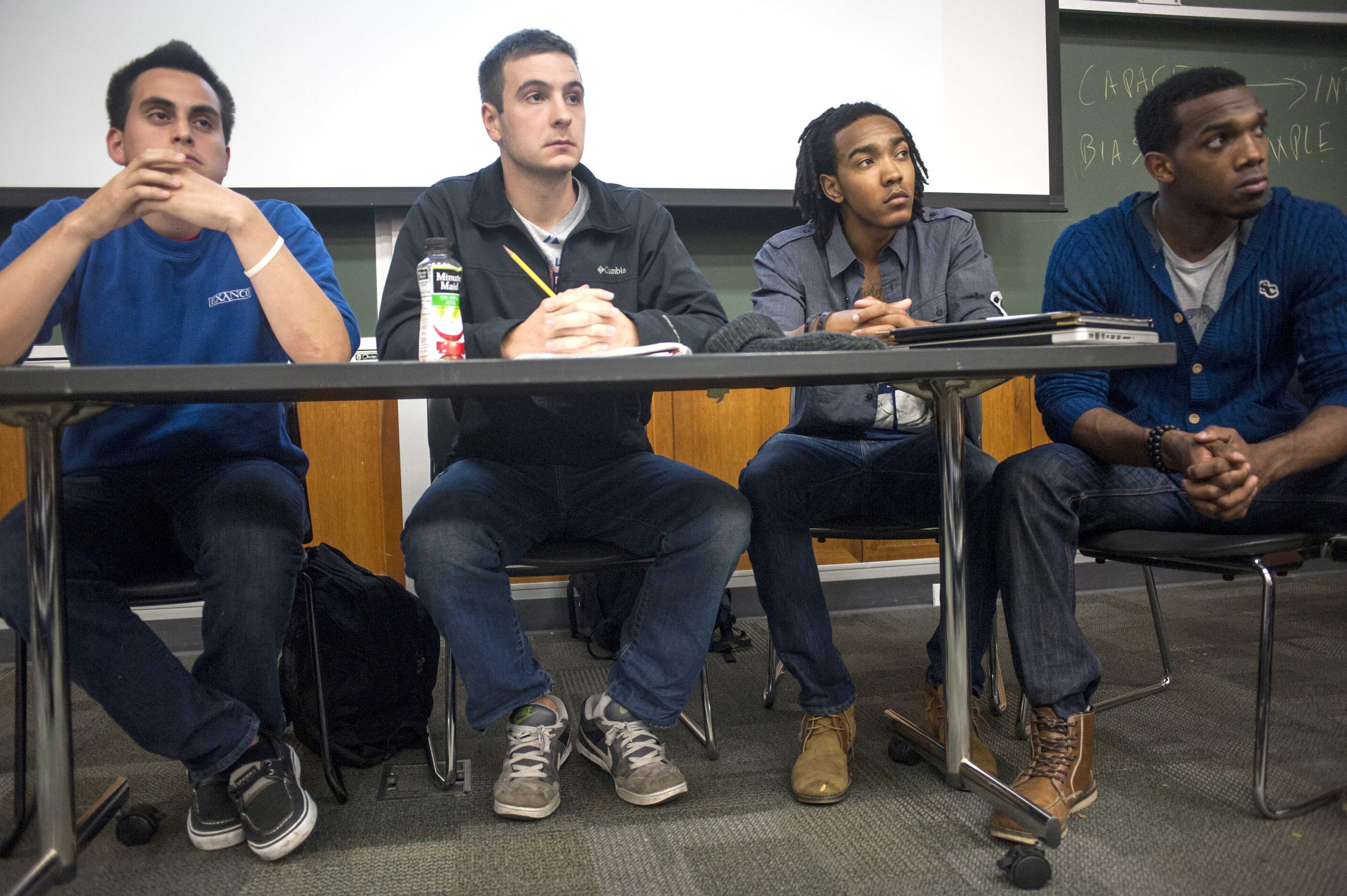 Northwestern students Daniel Flores, Andrew Jarrell, Justin Clarke and Tarik Patterson (left to right) debate race-based affirmative action policies in higher education. About 60 students participated in the Northwestern Political Union event Monday.
