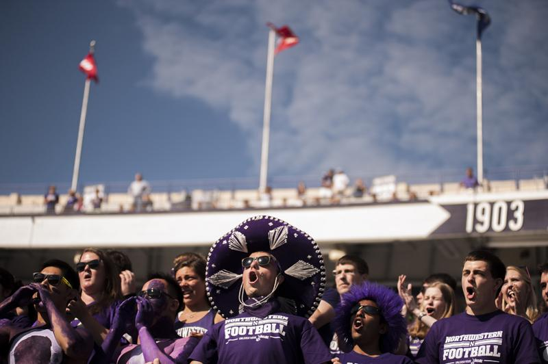 A+Northwestern+football+fan+cheers+during+a+home+game+earlier+this+fall.+Ticket+sales+reportedly+rose+more+than+50+percent+for+the+Wildcats%27+2012+season.
