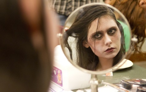 Weinberg freshman Marie Peeples puts the finishing touches on her zombie look for Jumpstart's
