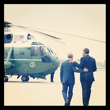 President Barack Obama walks to his helicopter with Chicago Mayor Rahm Emanuel after dropping in on the Windy City to vote early Thursday afternoon.