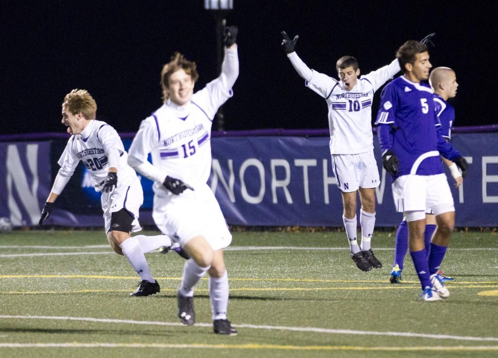 Northwestern midfielder Nick Gendron (20), midfielder Cole Missimo (15) and forward Joey Calistri (10) celebrate the Wildcats' victory over Western Illinois. The win advances NU to the second round of the NCAA Tournament.