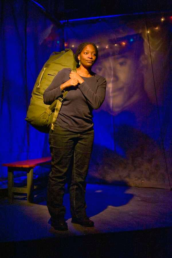 """Jenny Sutter (Lily Mojekwu) remembers her grandfather, also a former Marine, as she prepares to return home. """"Welcome Home, Jenny Sutter"""" runs through Dec. 23 at Next Theatre in Evanston."""