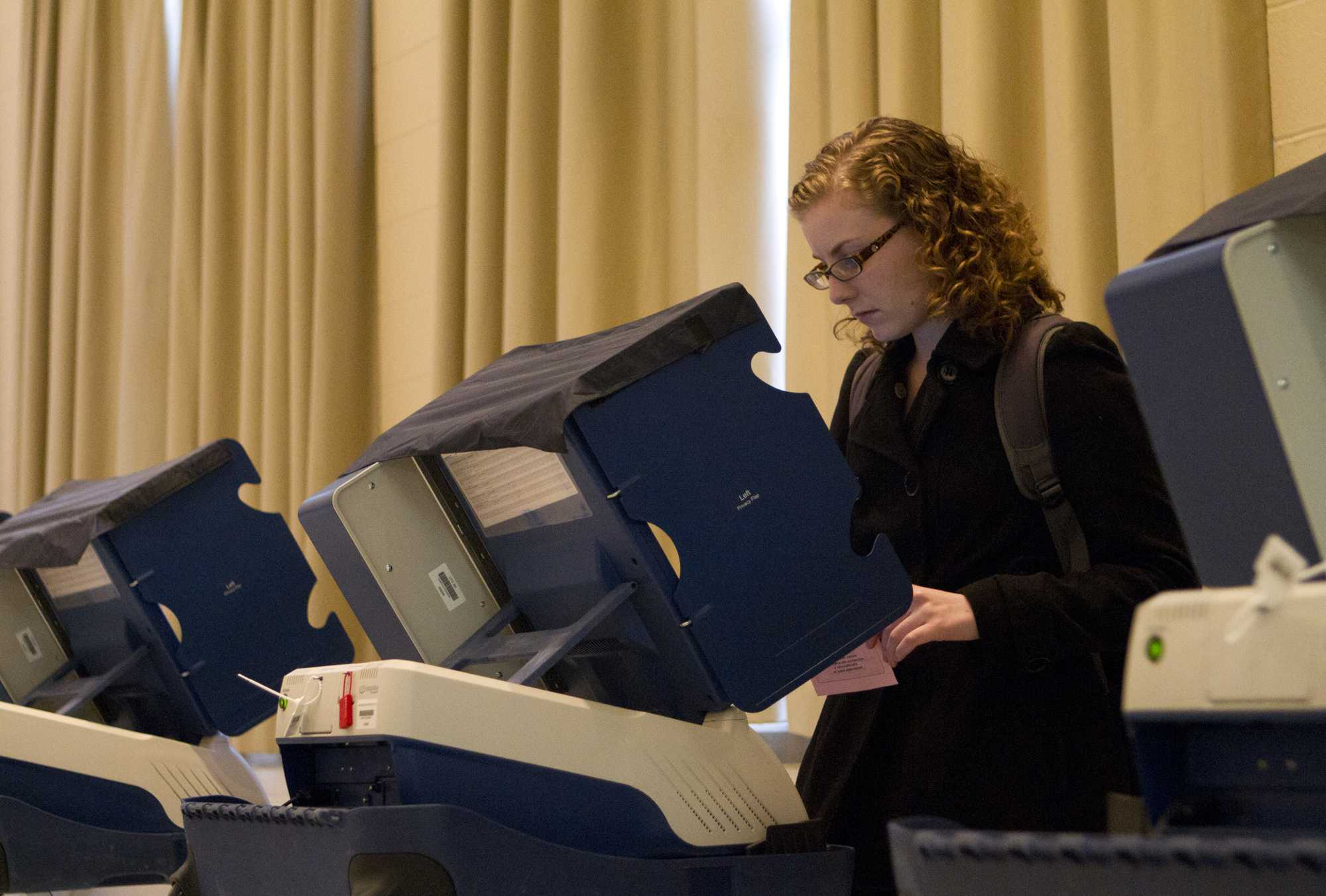 Weinberg sophomore Kayla Hammersmith casts her ballot for the 2012 presidential election last Tuesday in Parkes Hall. It was Hammersmith's first time voting.